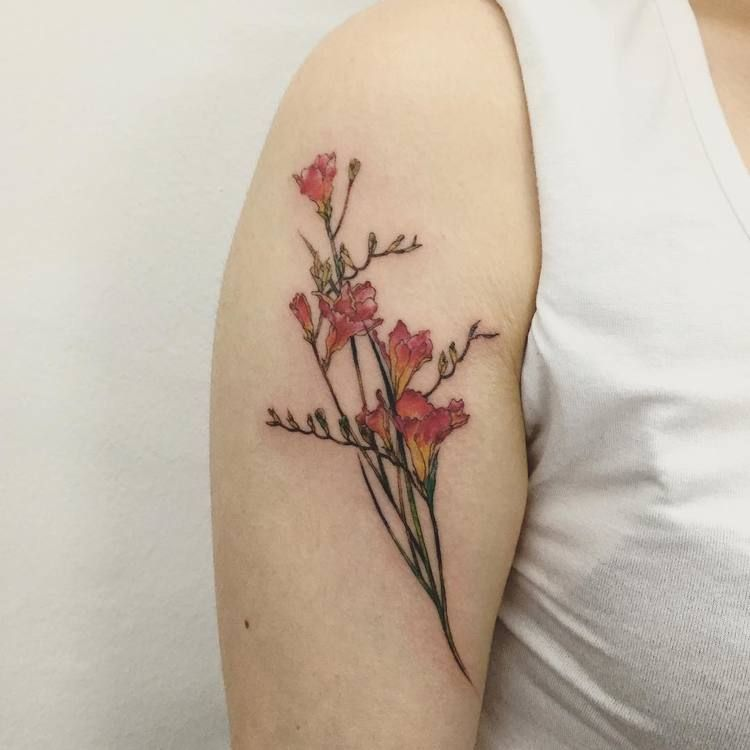 22 Beautiful And Delicate Freesia Tattoo Designs Page 2 Of 2 Tattooadore Tattoos Pretty Flower Tattoos Floral Tattoo Design