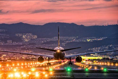 Traveling under the burning sky by bulkington23  airport airplane Osaka Japan osaka international airport bulkington23