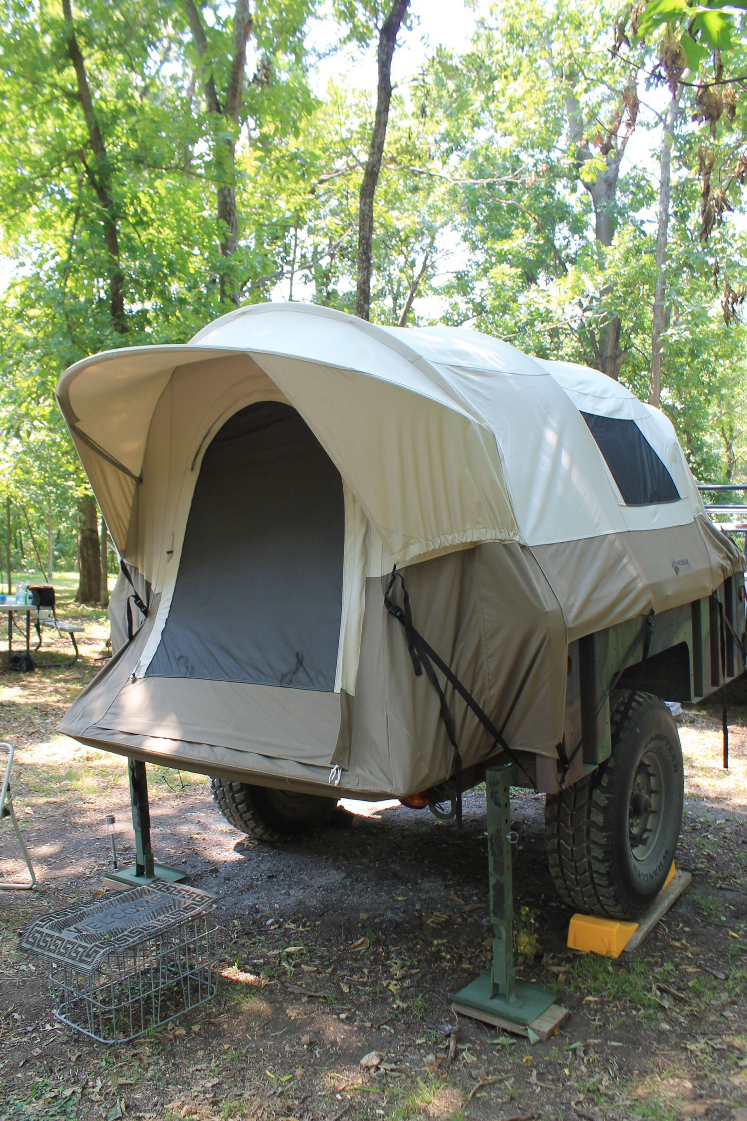 Army trailer with full sized truck bed tent on it | Camping