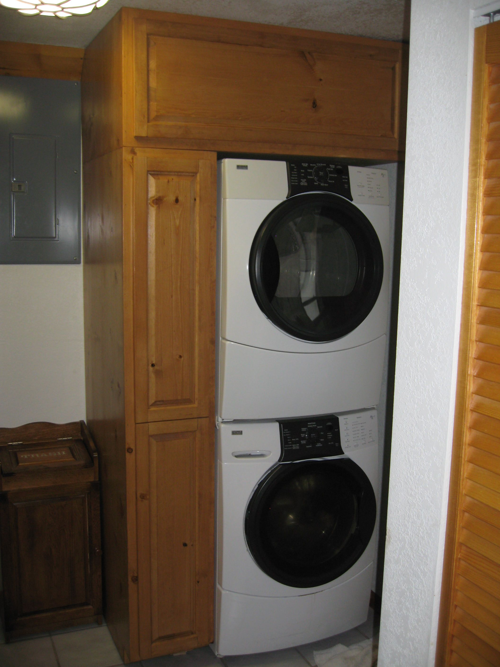 Custom Built Cabinets Around Stackable Washer And Dryer Laundry Room Storage