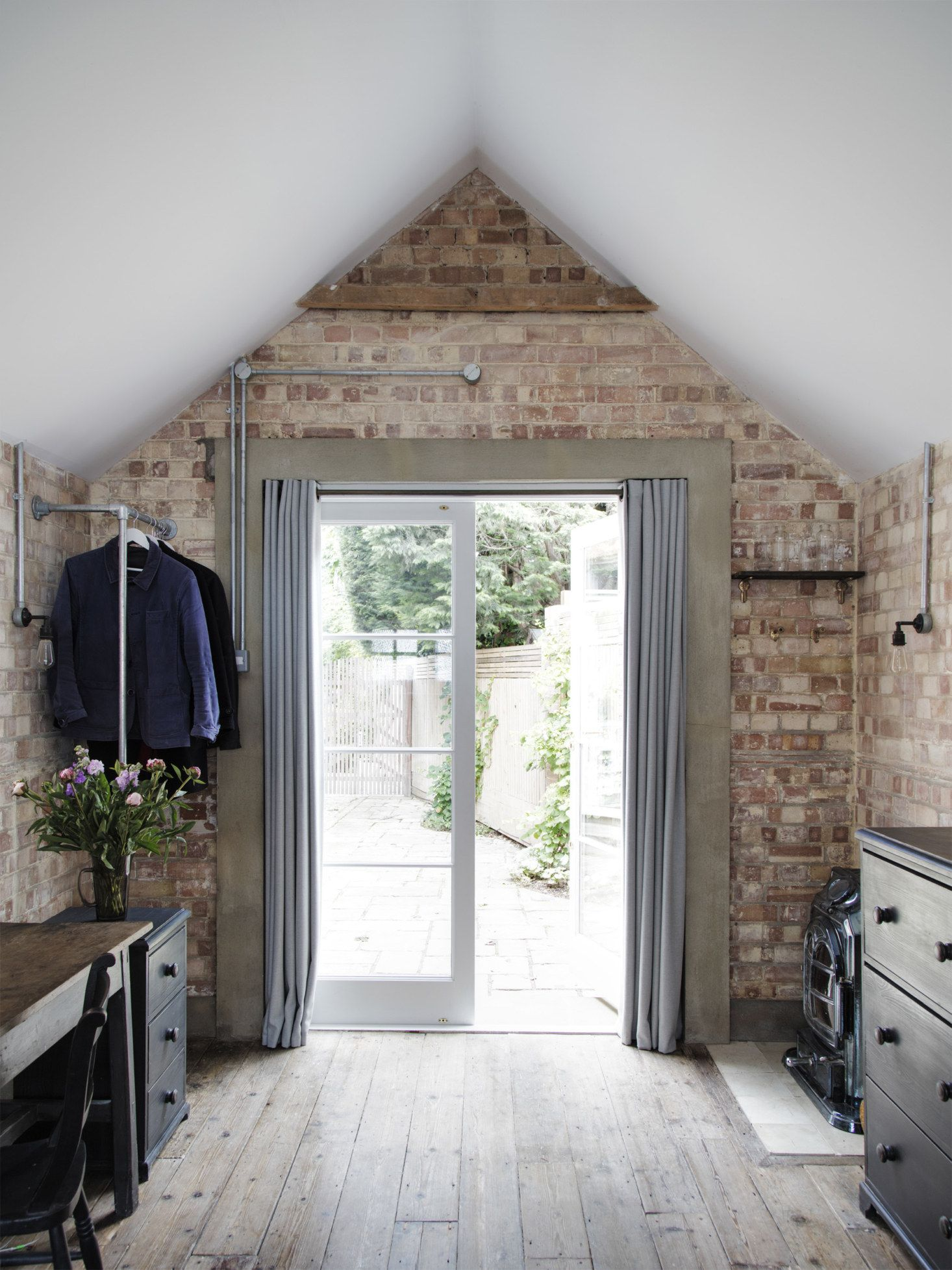 Photo of Garage conversion to a stylish guest room Mark Lewis interior design London