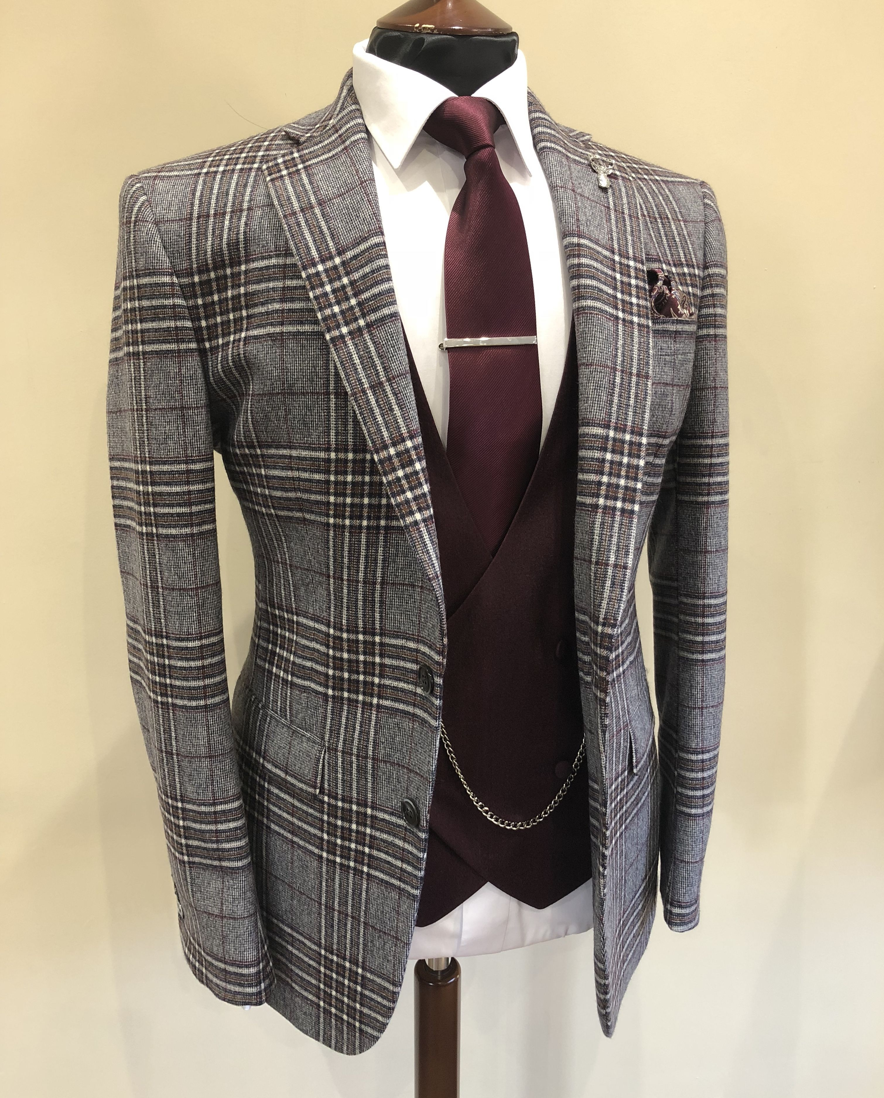 Burgundy Suit. For more info, call us on 01625 536 545
