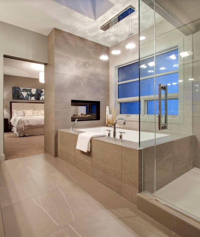 This Ultra Modern En Suite Holds A Grey Tile Covered Bathroom In Which A  Glass Shower Enclosure, Large Window Side Soaking Tub, And Pass Through  Fireplace ... Part 63