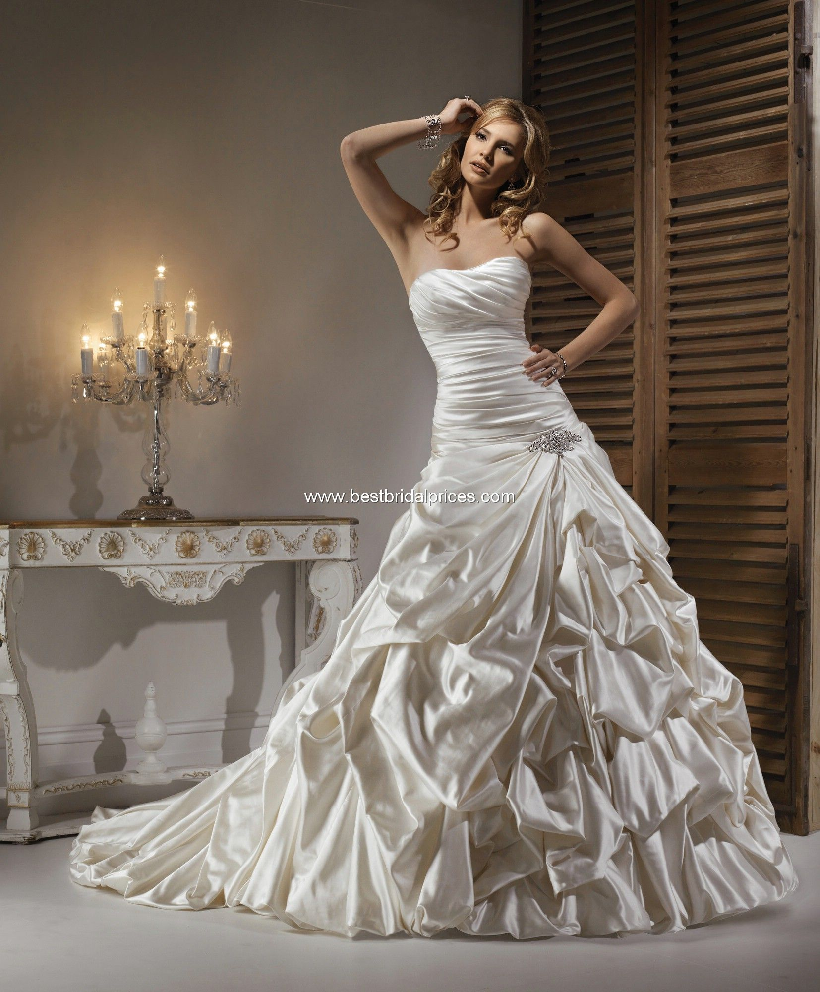Fancy Maggie Sottero uNicolette u Wedding Gown An strapless caught up gown with corset closure and jeweling