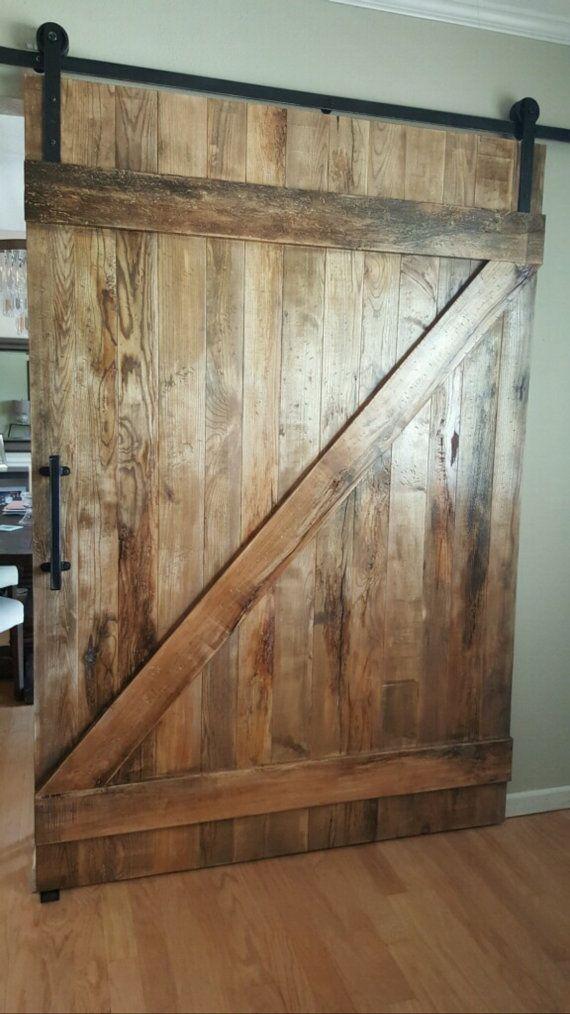 Custom reclaimed wood sliding barn door in 2019 - Reclaimed wood interior barn doors ...