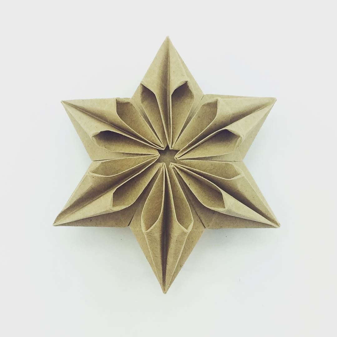 Star designed by xephirart origami origamistar paperfolding make a pretty modular origami star designed by salman ebrahimi this modular puffy star is made with 5 sheets of square paper no cuts or glue required jeuxipadfo Image collections