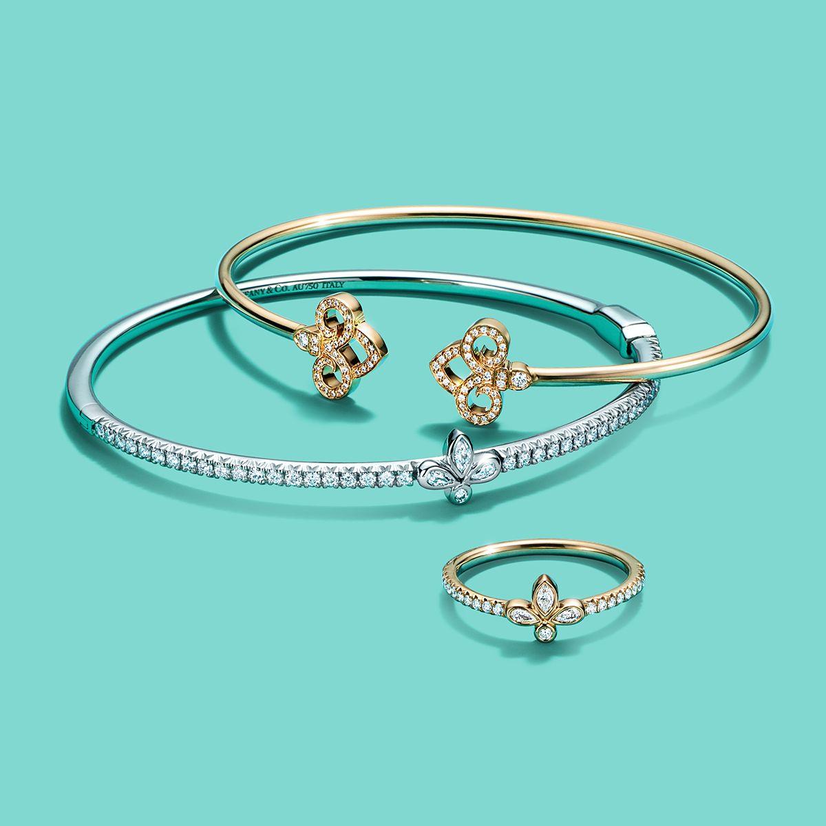 49c30f53563f9 Tiffany Fleur de Lis designs in 18k yellow and white gold. | Happy ...
