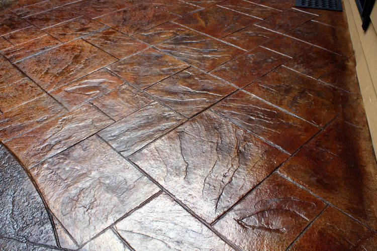 This is called stamped concrete then they paint it with several
