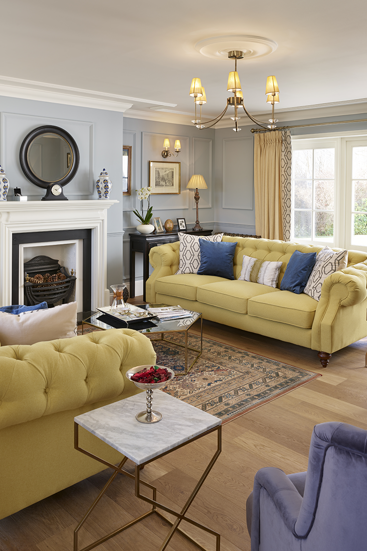 Traditional Luxurious Living Space With Pale Yellow Chesterfield Sofas Blue Walls And Decor Home Living Room Yellow Walls Living Room Traditional Living Room