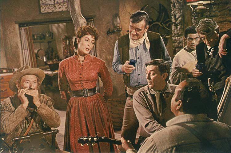 Robert Mitchum, John Wayne, Paul Fix, Charlene Holt, and