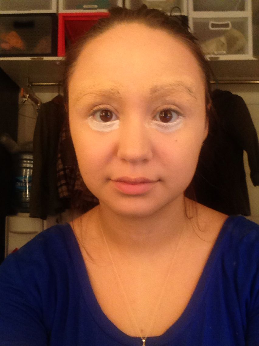 blocked out eyebrows using glue and concealer, white under