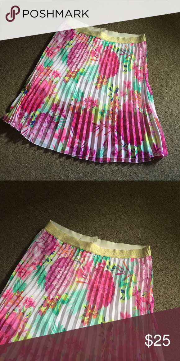 Perfect Floral Summer Skirt size XL 14/16 NWT Perfect Floral Summer Skirt size XL 14/16 NWT. Bright beautiful colors of pink, green and yellow with a gold waist band. Pair with a jean jacket or better yet a black and white striped blazer( floral and stripes together are so in). Candies Skirts A-Line or Full