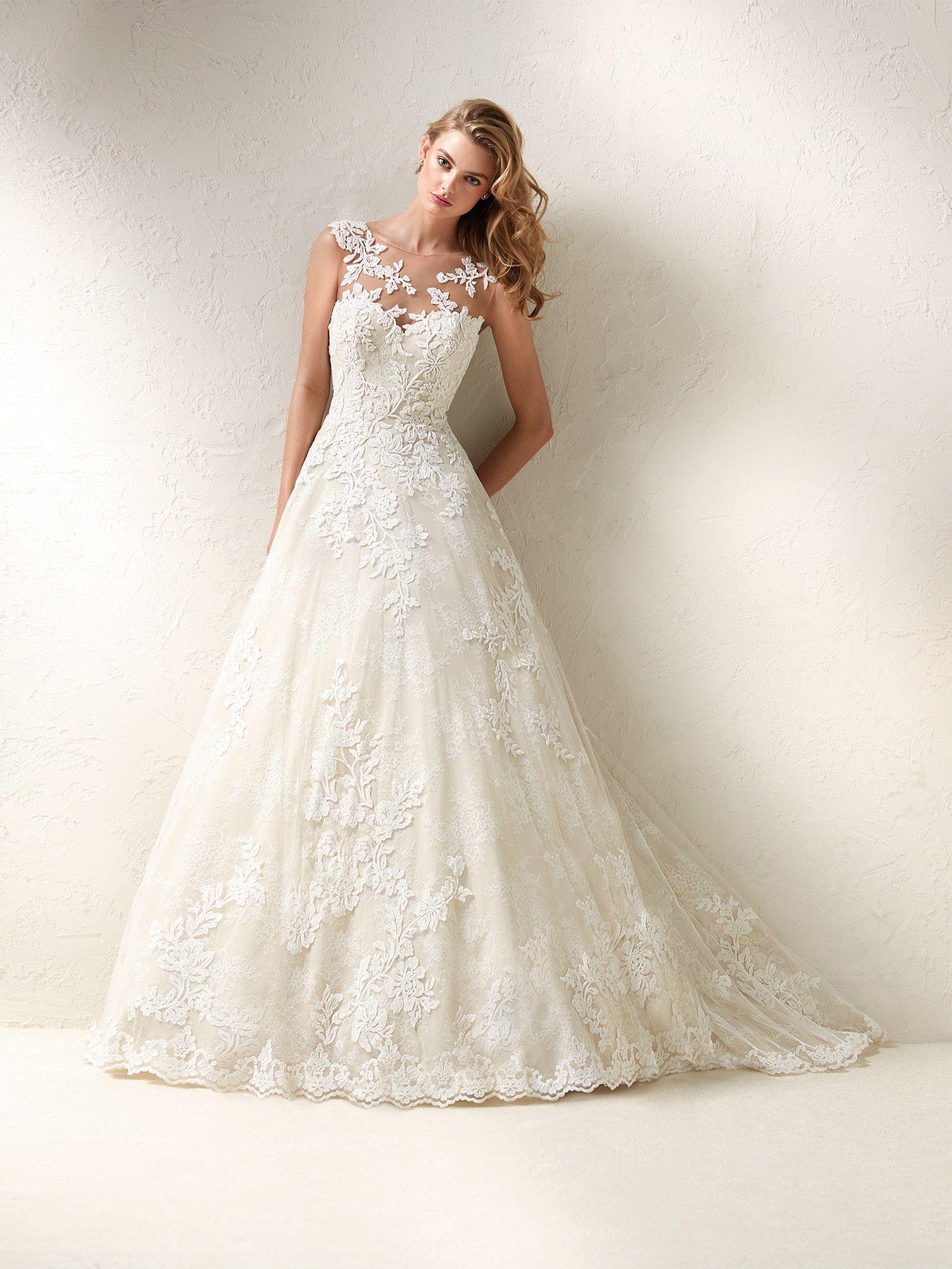 Dracme: Princess design wedding dress with full flared skirt, illusion bodice and back and gemstone details - Pronovias