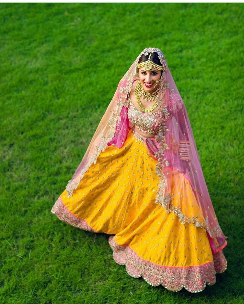Such a vibrant and summerish twirling shot indianbride