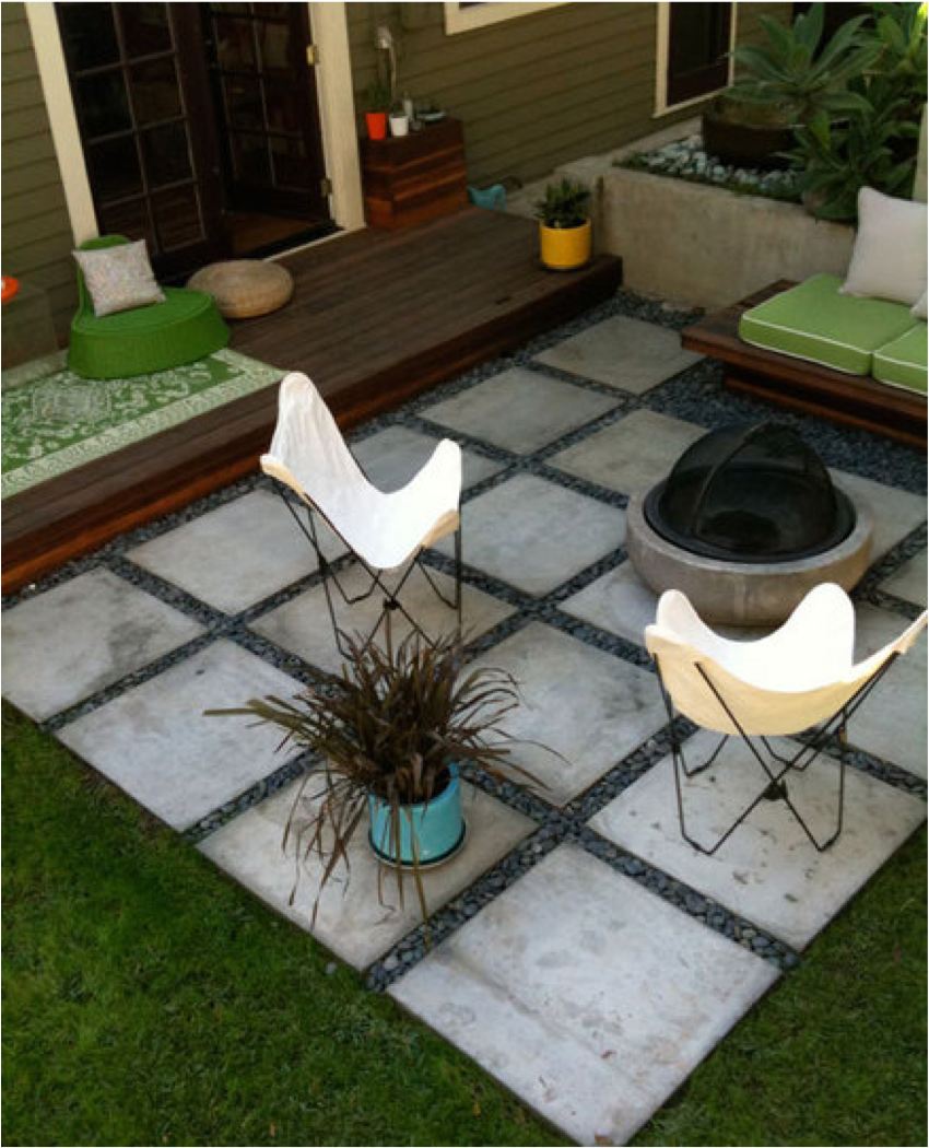 Square paver patio with stones between pavers