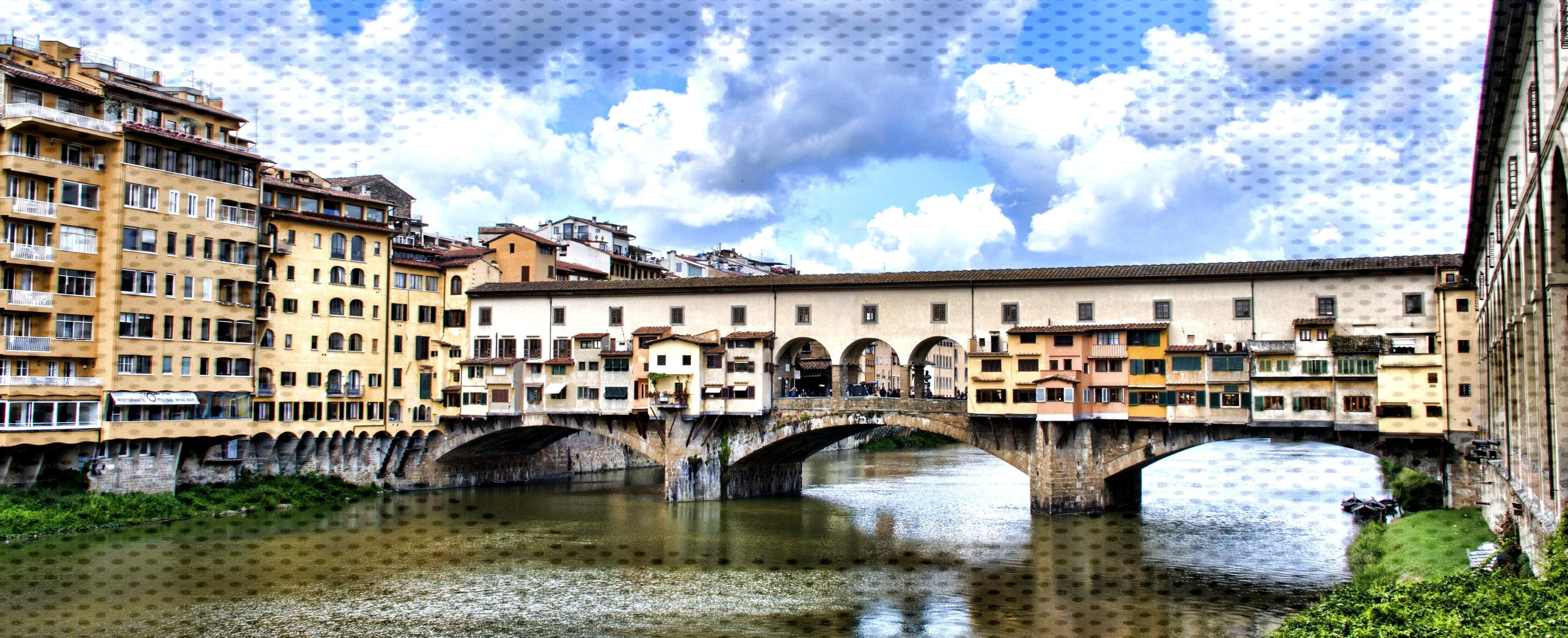 gray concrete bridge near yellow buildings during daytime   european History Wallpaper