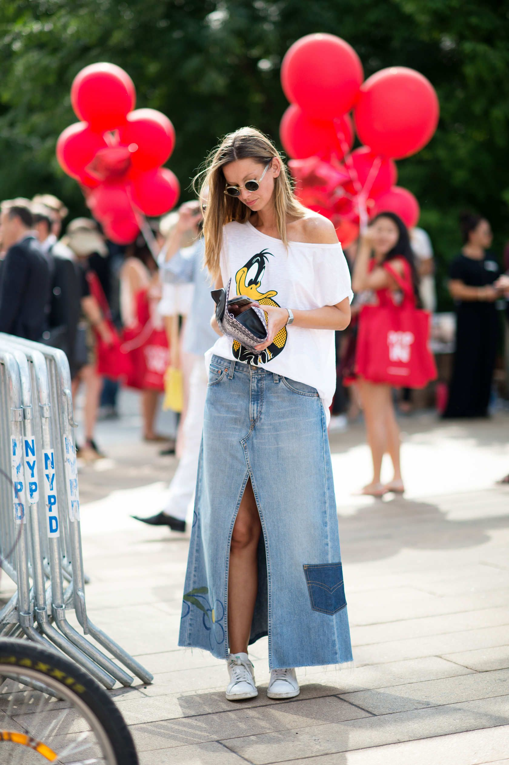 Between the off-the-shoulder Daffy Duck tee and that maxi denim skirt, this entire ensemble could have come out of a dELiAa*s catalogue circa 1994. Photo: Youngjun Koo/I'M KOO