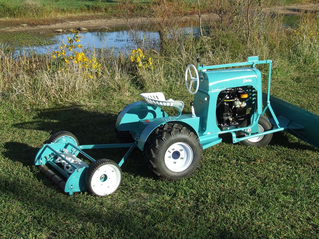 bantam with snow plow and rear reel type mower