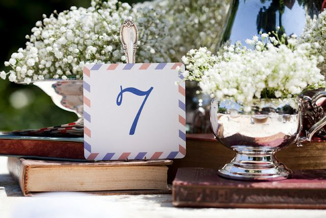 airmail themed DIY table numbers held by bent vintage forks - what a great idea!