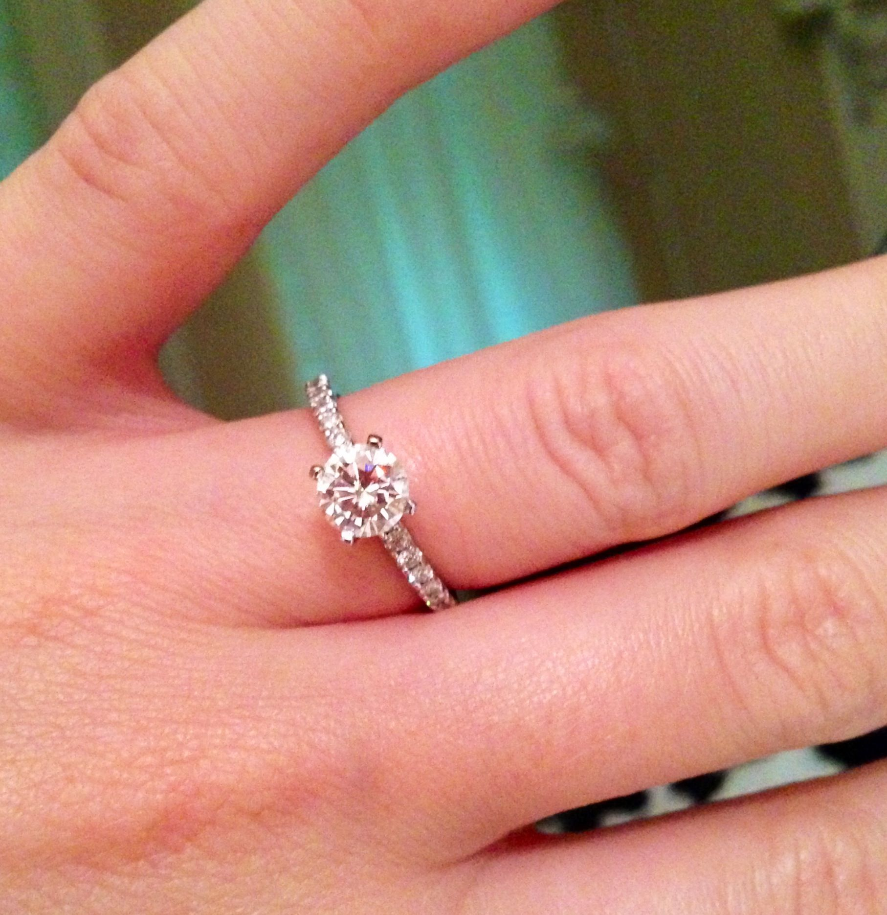 Solitaire round diamond with shared prong band. This is what I want ...