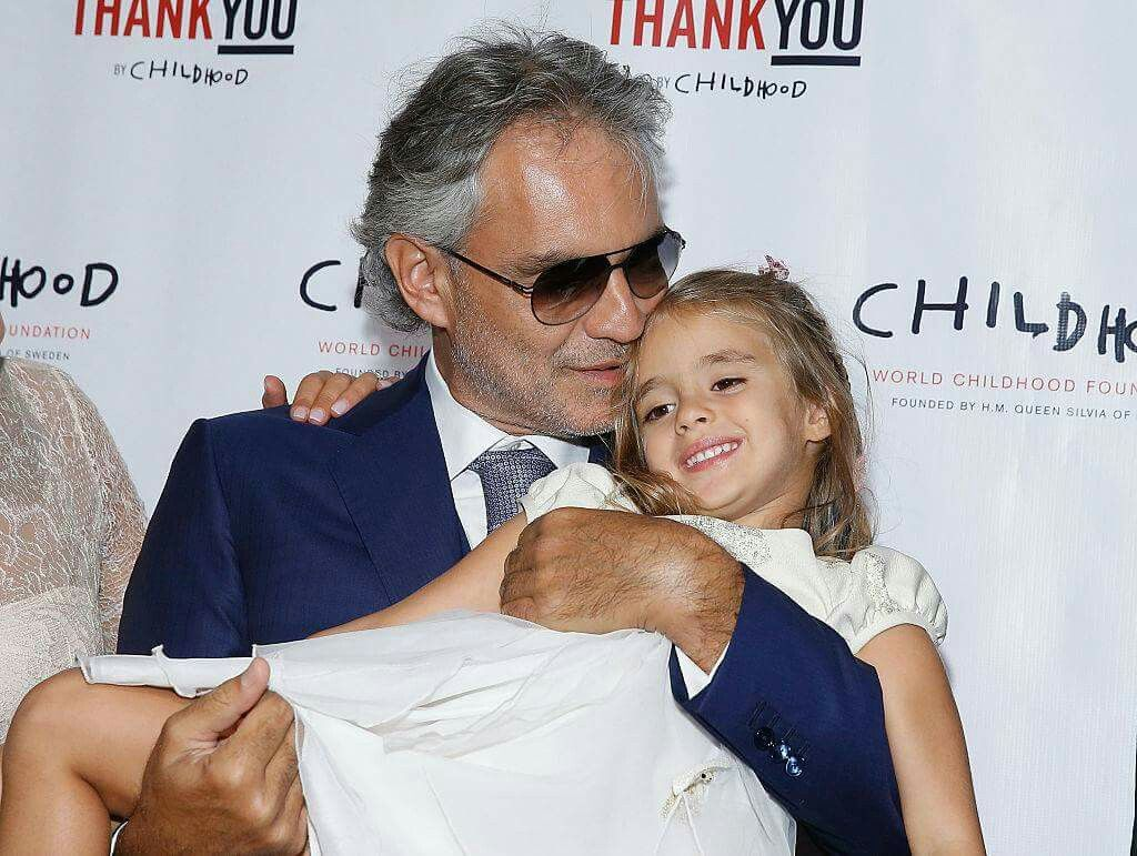 Andrea Holding His Daughter Virginia At A Fundraiser That Was