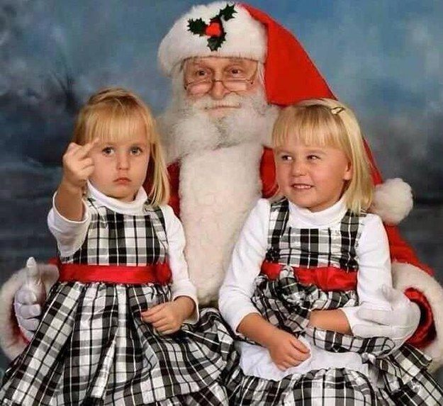 The little girl on the left, who is not being shy about her feelings on having to pose for this picture: | 22 Kids Who Are Totally Over Taking Their Photo With Santa