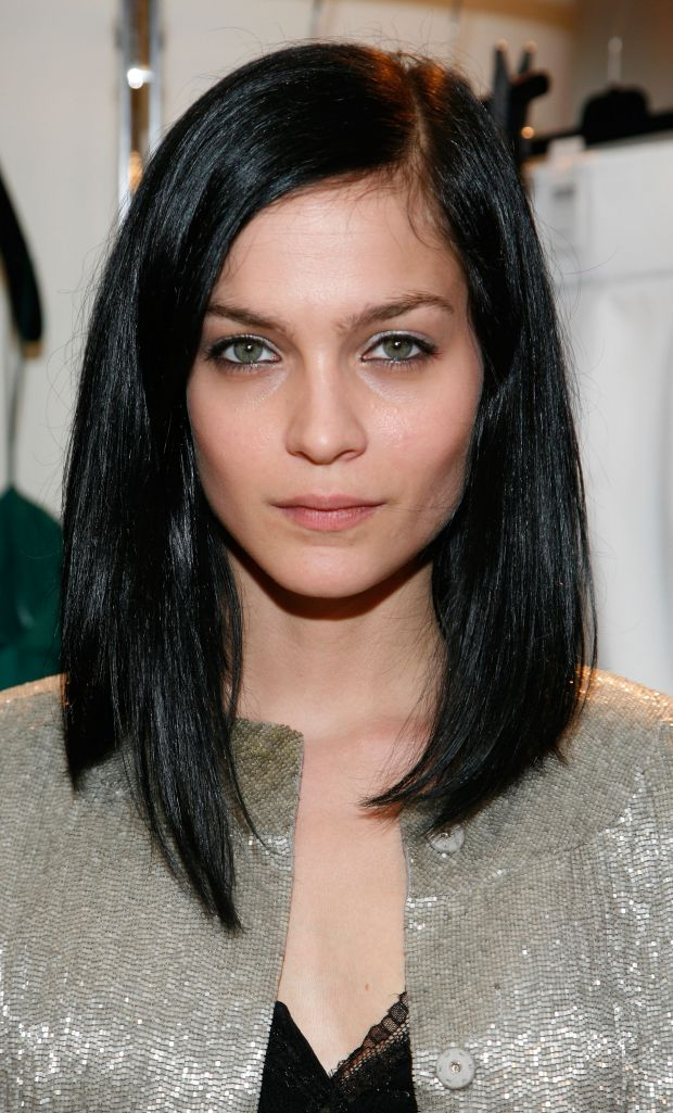 Jet black hair cut with long layered bob.