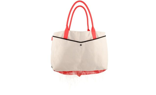 The worst part about the beach? The sand seems to follow you everywhere. The innovative Quirky Shake Tote, however, is a nifty--and chic--solution: open the flap that conceals netting at the bottom of the bag to shake out every last bit of beach. quirky.com, $89.99. (From: Beach Gear You'll Need This Summer)