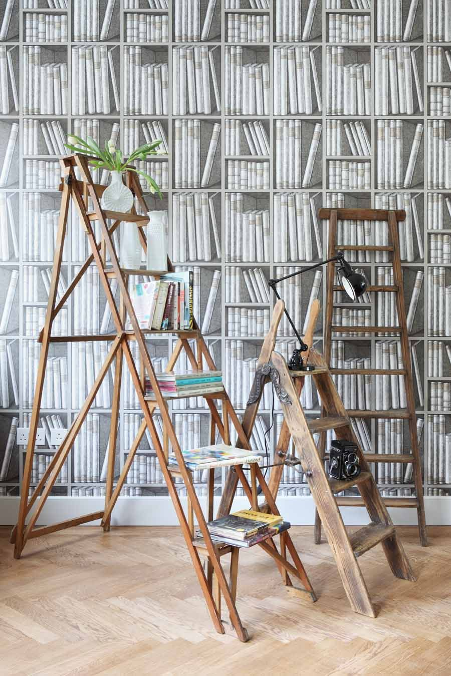 Cole & Son Ex Libris wall paperprovides a focal feature backdrop for vintage ladders, which offer imaginative shelves for displaying vintage finds.
