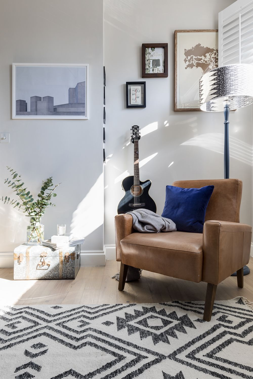 Gallery wall in a bright reading corner. Light grey walls in Farrow ...