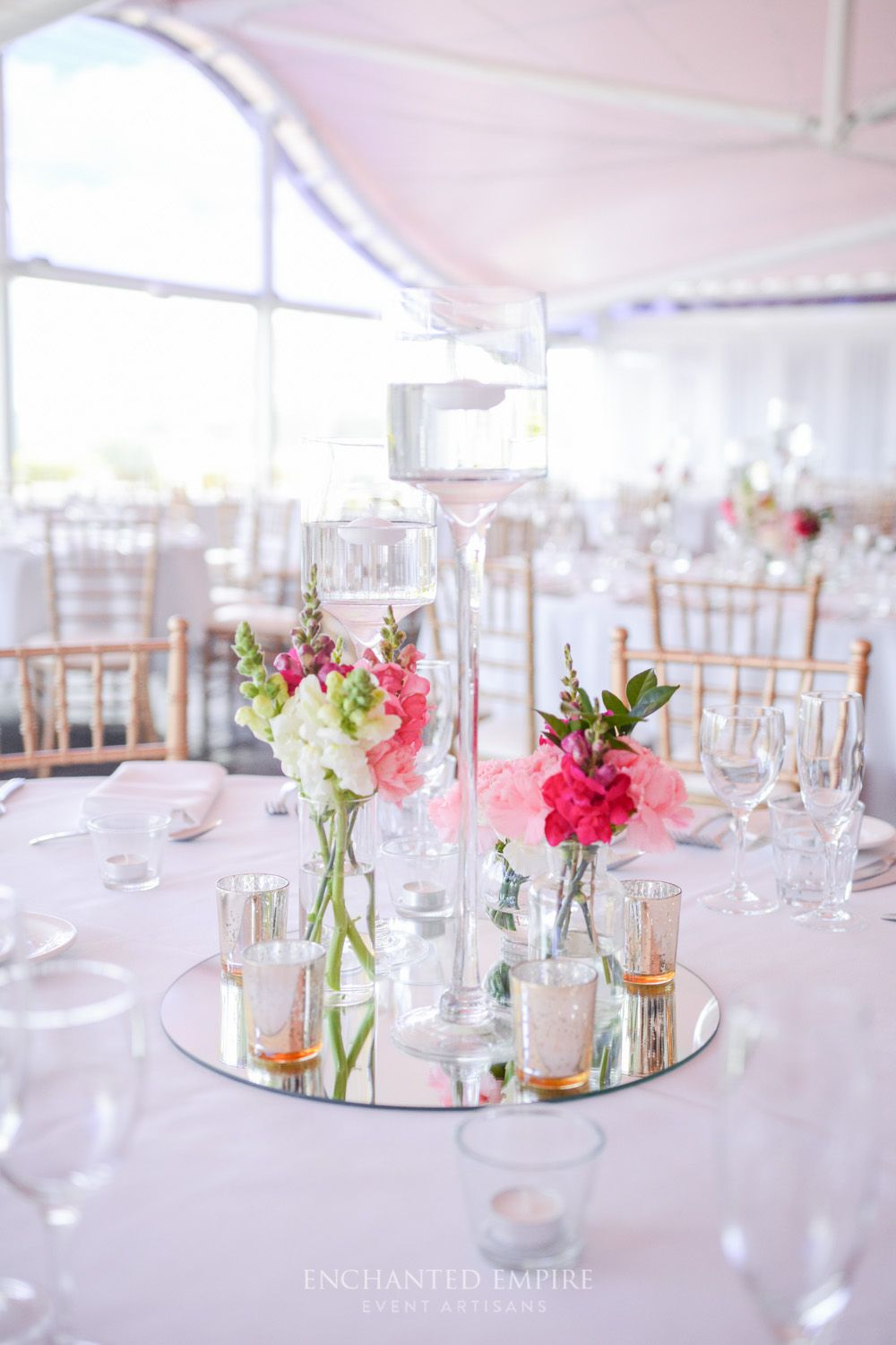 This wedding decor was simple and chic. White tablecloths with gold ...