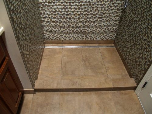 Large format tiles with matte finishes can be used in single slope