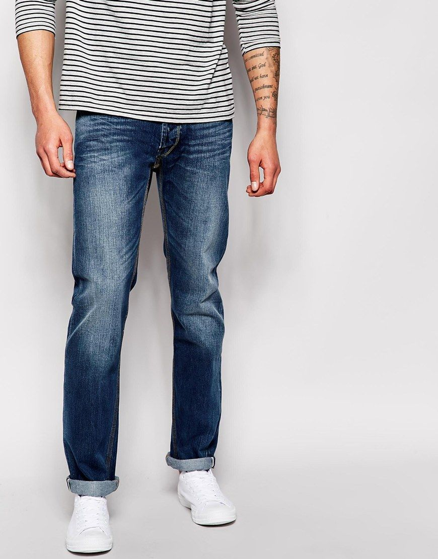 Jeans by Blue Collar Worker Non-stretch denim Button fly Contrast stitching  Whisker detail to