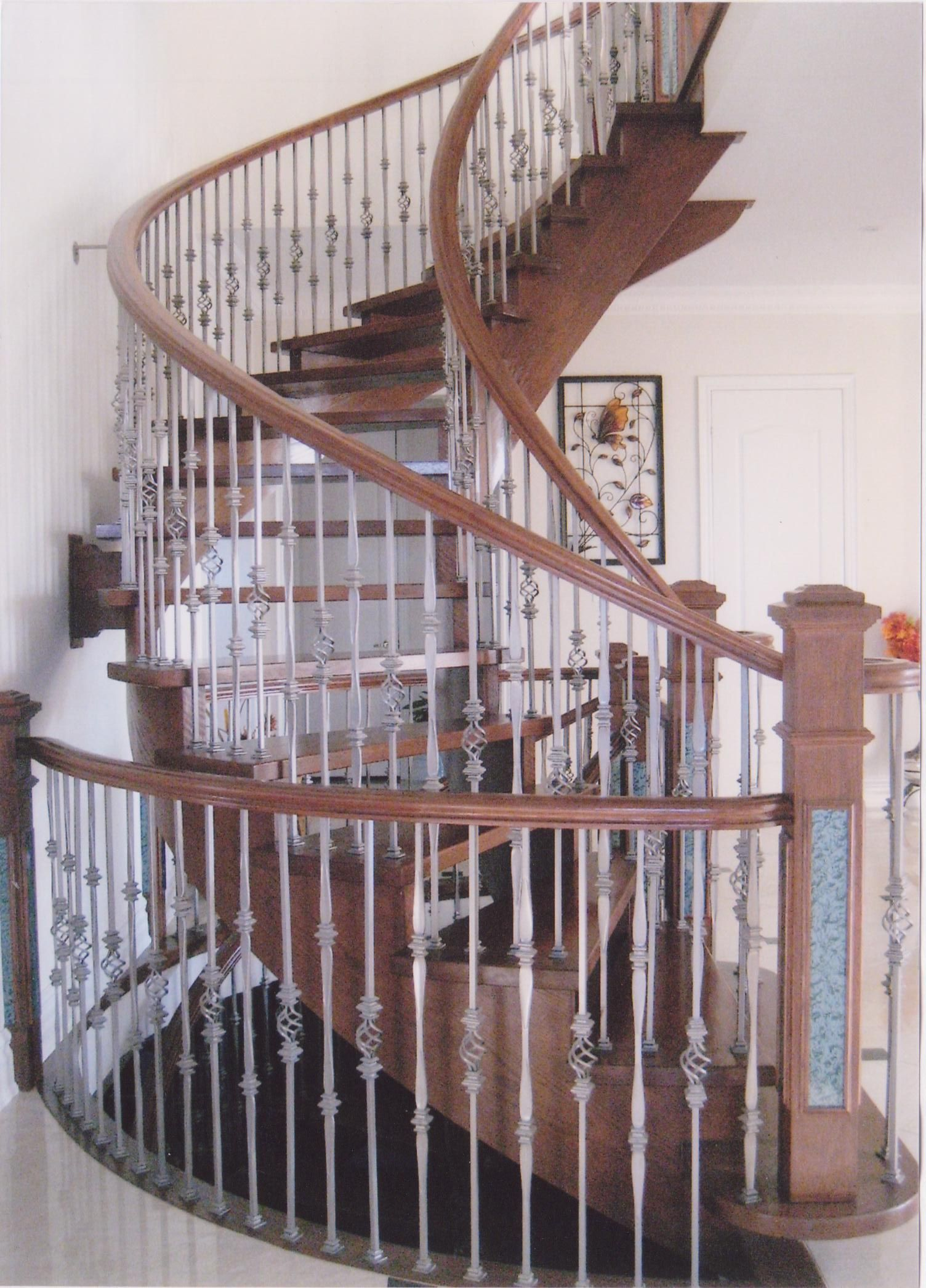 Open Staircase Without Risers, Circular Staircase. Iron Pickets