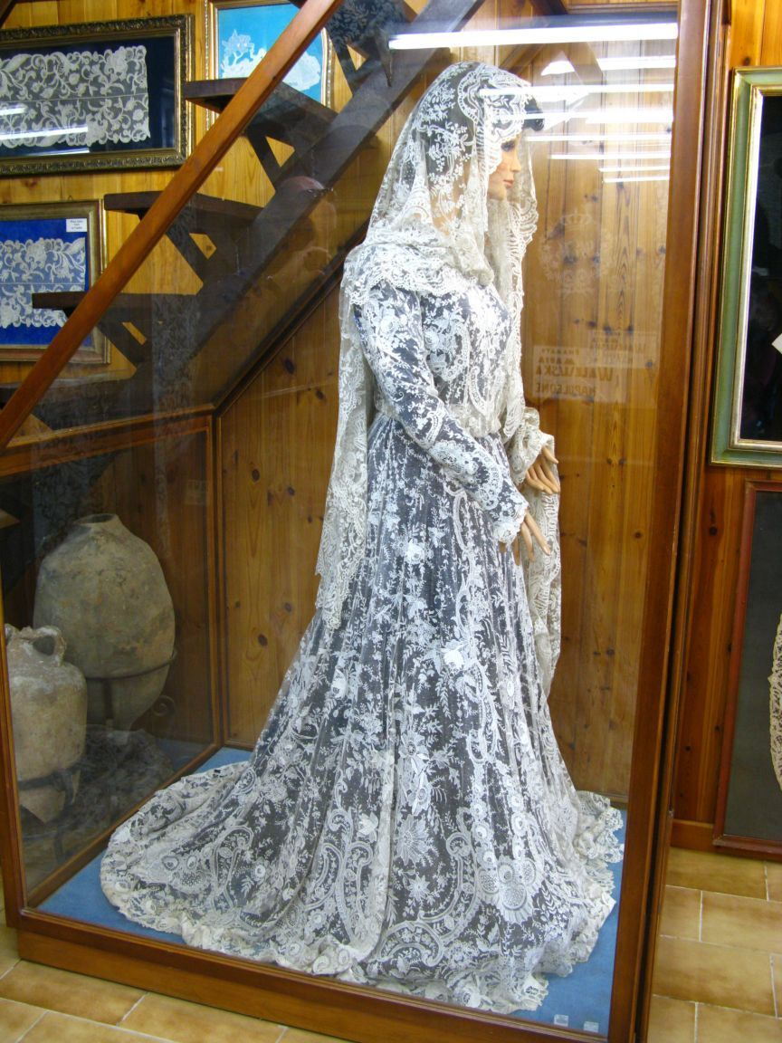 Hand made burano lace wedding dress a little much to for Wedding dresses made in italy