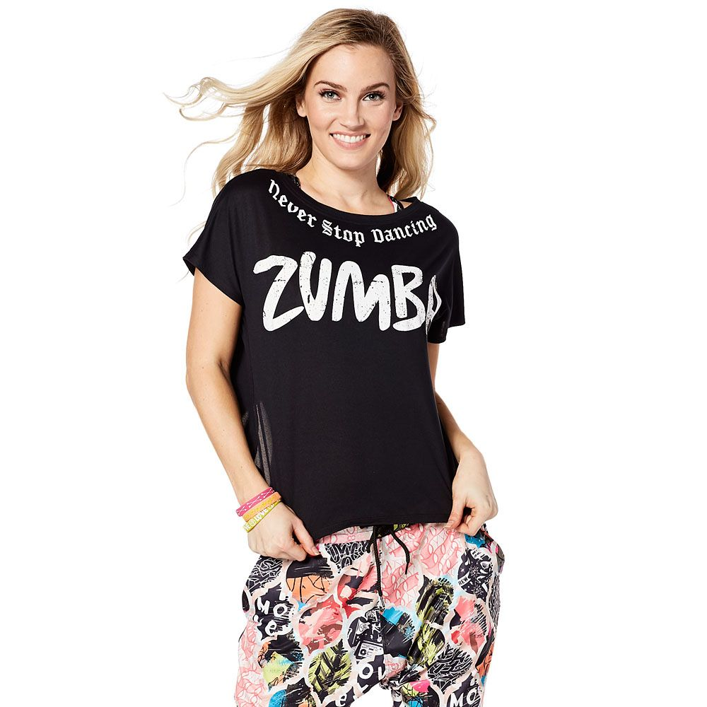 NEVER STOP DANCING BOXY TOP - BACK TO BLACK ------- Go on with your fab self in the Never Stop Dancing Boxy Top! This short length top features an open back, folded hem and a funky tattoo-inspired design.