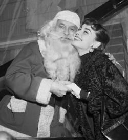 Audrey Hepburn with Santa Claus, Christmas, 1950s.