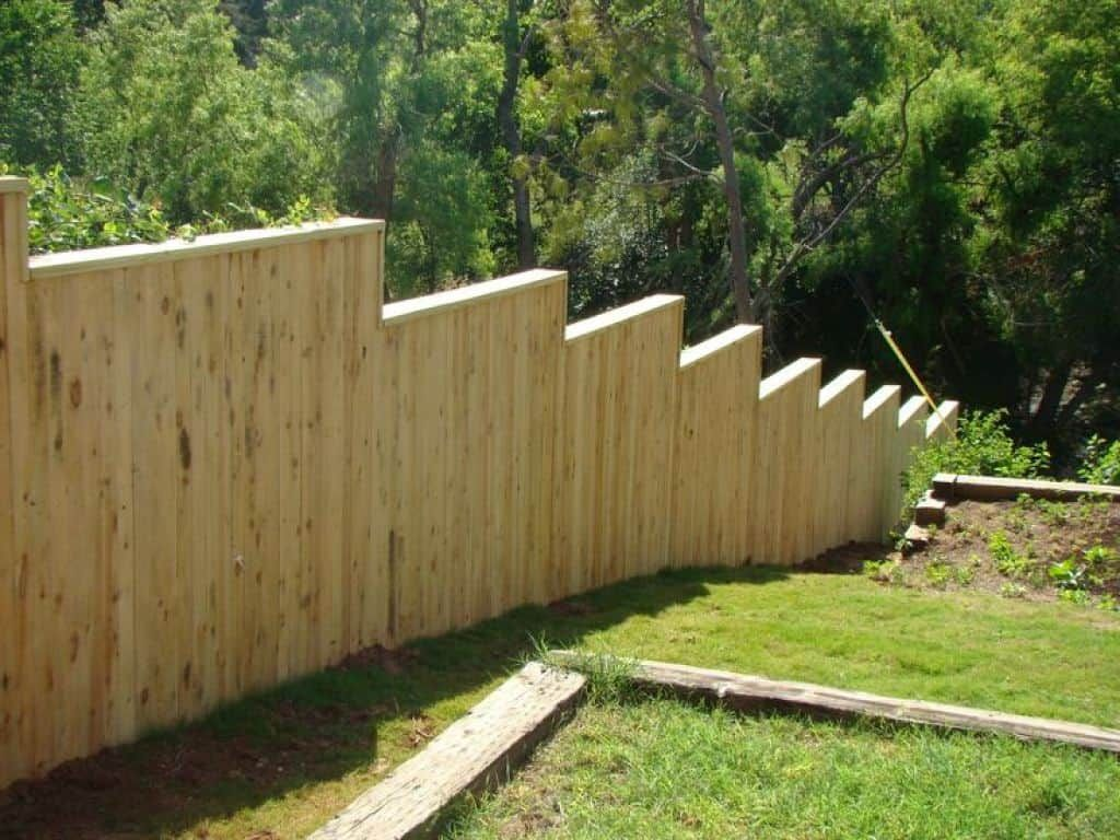 instructions to build fences on a slope in 2020 sloped on inexpensive way to build a wood privacy fence diy guide for 2020 id=15280