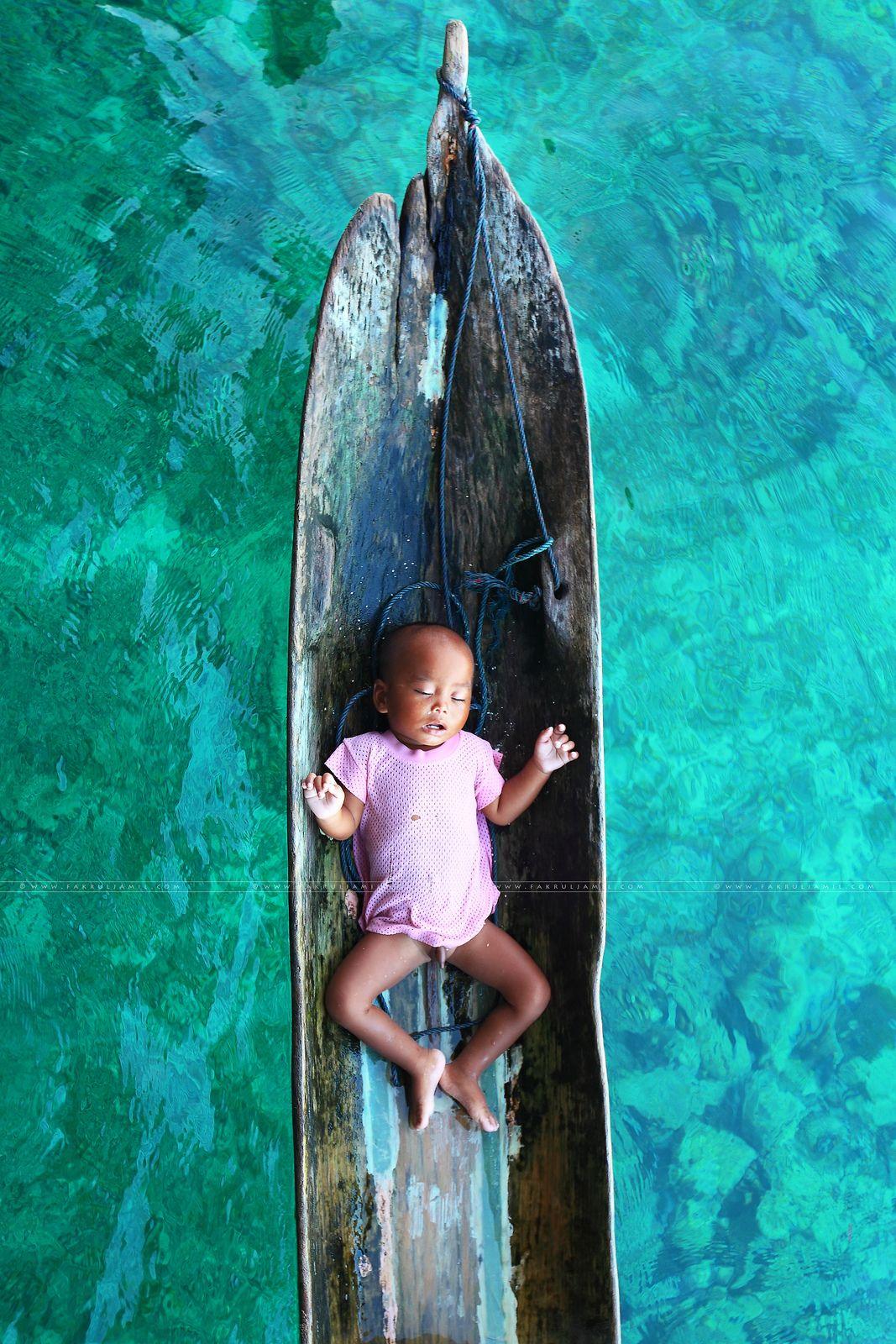 Sea Gypsies Baby Sleeping On Bajau Traditional Sampan In