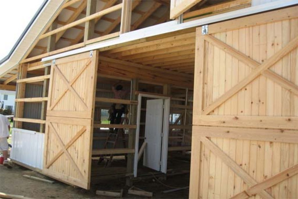 Exterior Sliding Barn Door Hardware With Crossed Braces And Unpainted Barns Garages