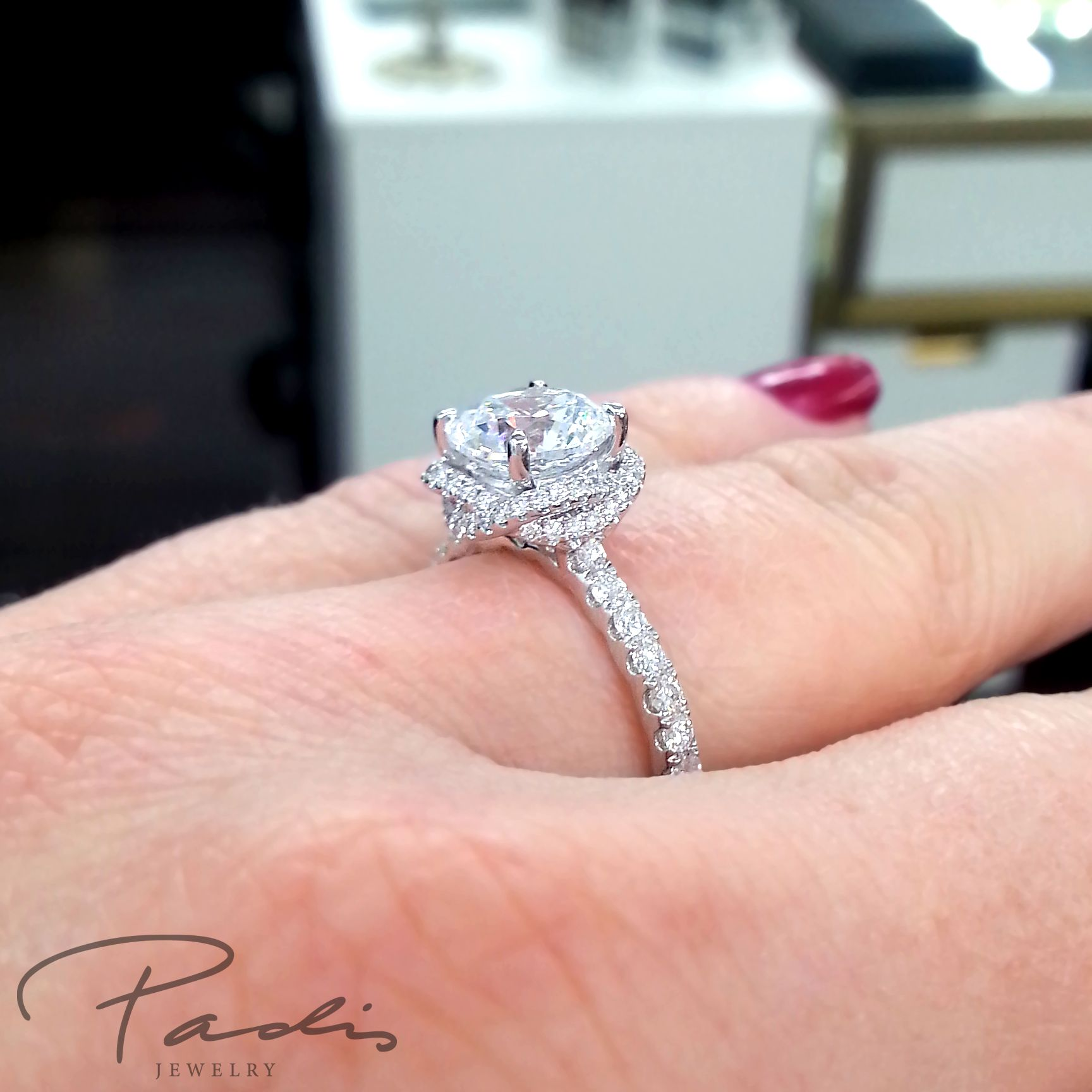 Unique A. Jaffe engagement ring with intertwined diamond halo ...