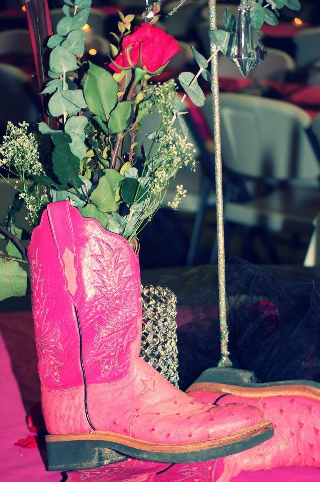 Pink Ostrich Boots Used For Decorations At A Wedding Reception In Lubbock Texas At Double B Party Barns Catering Boots Diy Barn Parties Ostrich Boots