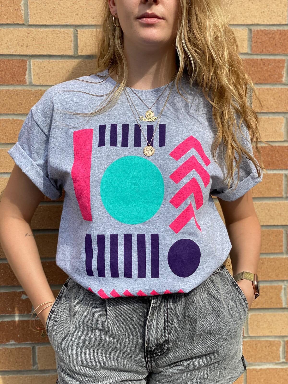 Excited to share this item from my #etsy shop: Hand printed graphic T-shirt #handprinted #geometricshapes #womenstshirt #hotpink #graphictshirt #printedtshirt #brightcolors #graphicshapes #tshirt
