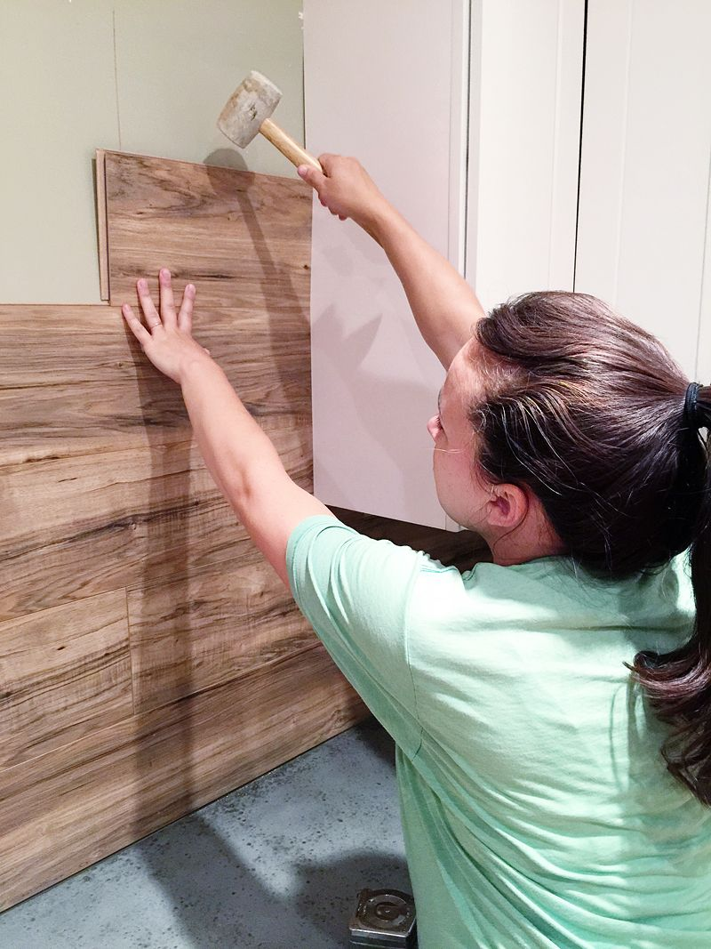 Laminate Flooring Backsplash  It looks like WOOD   design     DIY Laminate Back Splash    Wood walls are a total normal thing now  I see  pallet walls CONSTANTLY