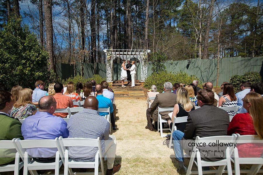 The Brides saying their vows outside at the Payne Corley House, Atlanta GA