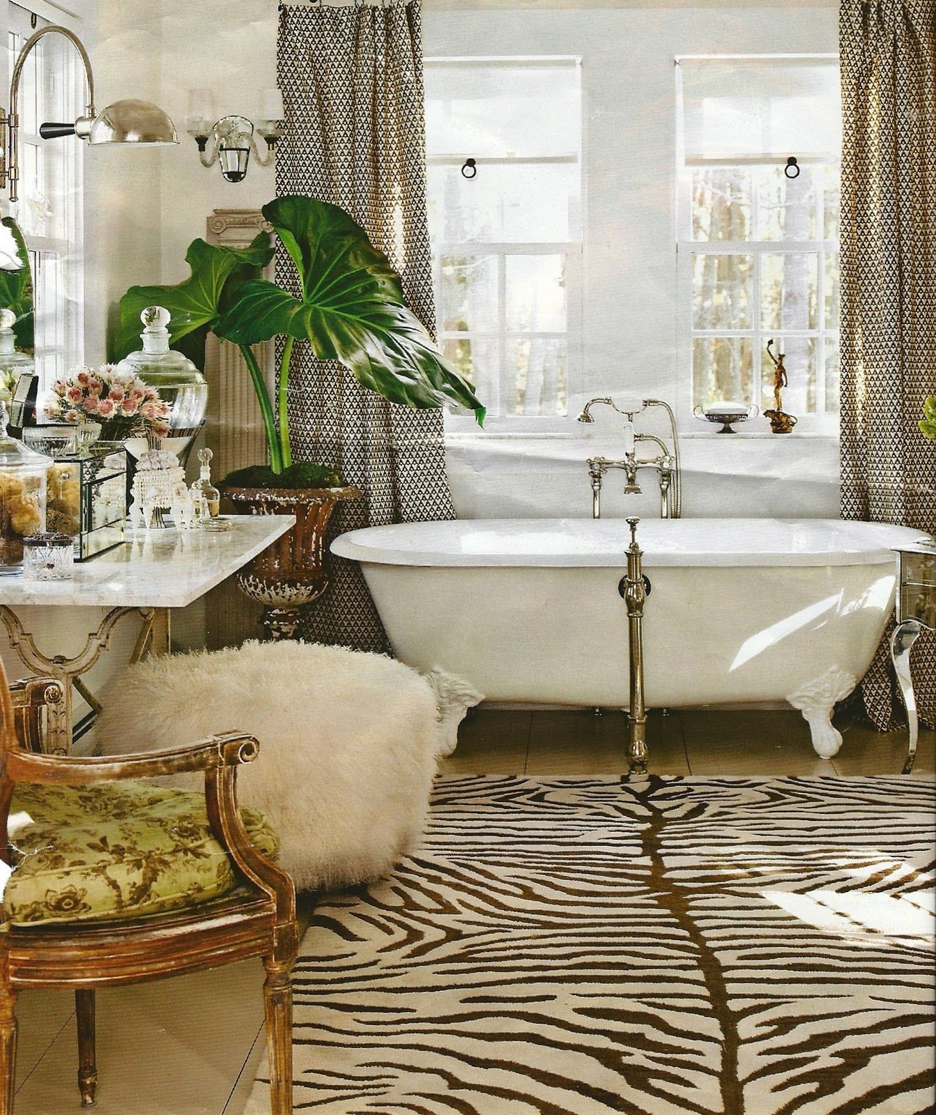 chocolate zebra rug with powderpuff vanity stool | bath