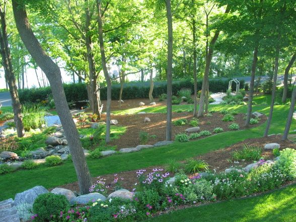 sloping backyard design sloping escape this was a wooded sloping lot and my husband had the. Black Bedroom Furniture Sets. Home Design Ideas