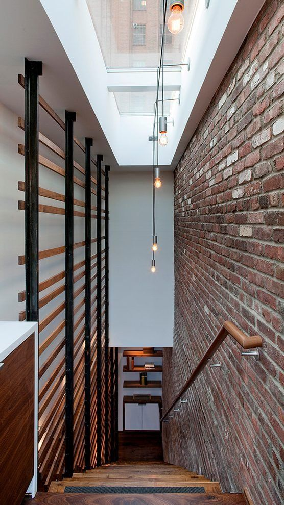 Hanging Pictures Over Stairs 9 Accent Brick Wall Staircase With Straight Run Skylight Loft Style Living