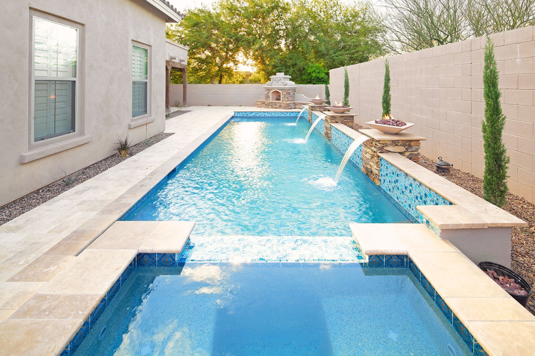 Rectangular Pool With White Stone And Fountains Rectangular Pool Pool Designs Swimming Pools