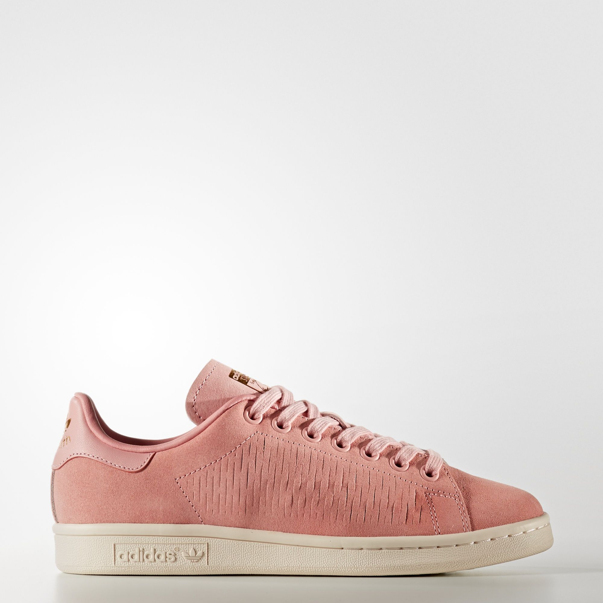 8a3c1f0ca61ed The crisp tennis style of the iconic Stan Smith gets a soft makeover. These  women s
